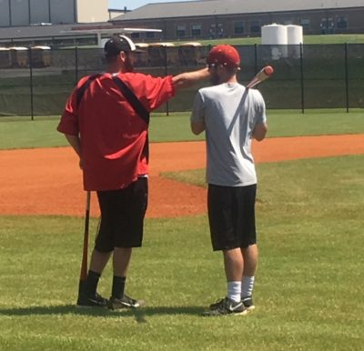 Head Baseball Coach Davis discusses preparation for tournament with Assistant Coach Ferrell.