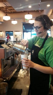 Rachel Treadwell prepares coffee drink for customer