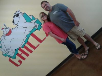 Dorothy and Jeff Tinsley stand in front of the Chillz bear. Customers can take a picture and post to social media for a ten percent discount here.