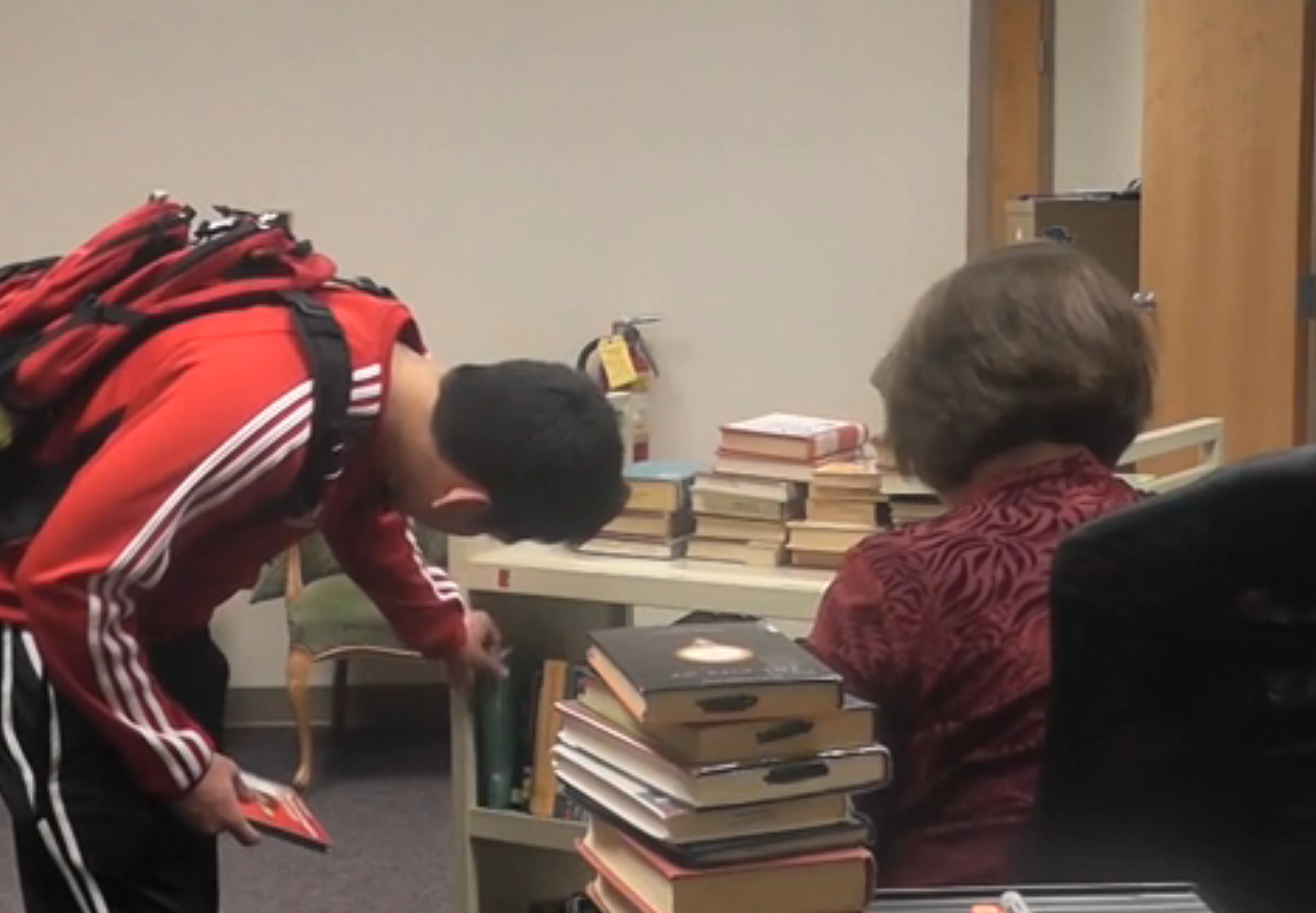 Librarian conveys love of books to students