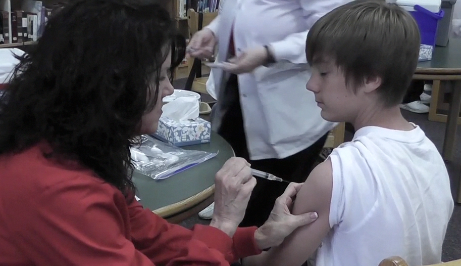 Students, teachers endure pain of flu shots
