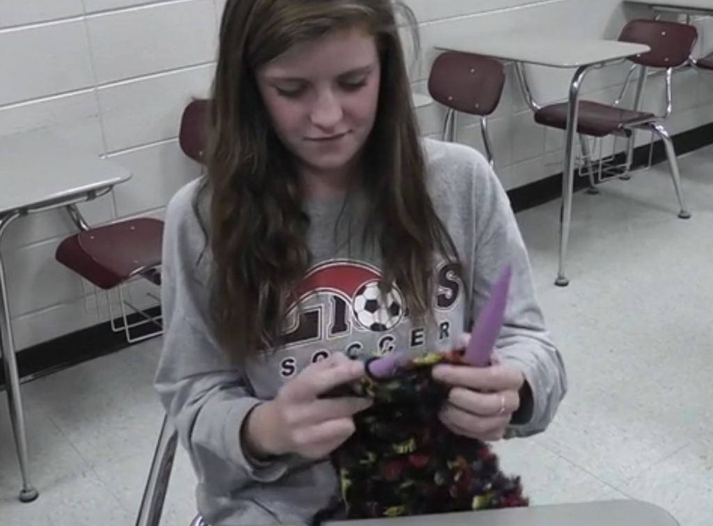 Teacher shares love of knitting with class