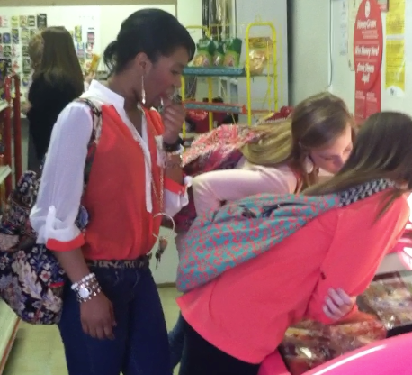 Students practice Spanish in trip to mercado